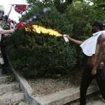 one-counter-protester-used-a-lighted-spray-can